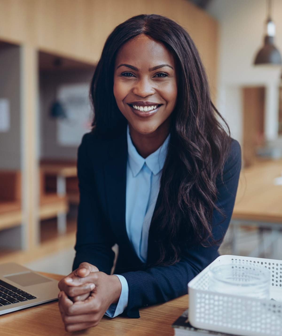Smiling young African American businesswoman working in an office